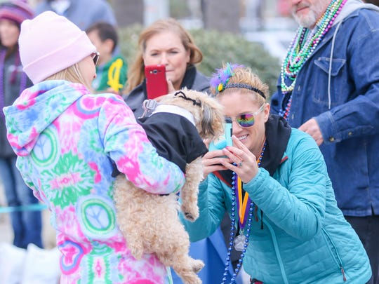 Celebrating its 8th year, the Kids and Kritters Mardi Gras parade, sponsored by Gulf Breeze Animal Hospital, makes its way around the Casino Beach parking lot on Saturday, February 3, 2018.