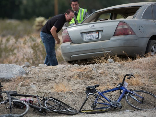 Two cyclists participating in the 2018 Tour de Palm Springs were struck by a vehicle speeding on Dillon Road near the intersection with 30th Avenue. One of the cyclists was pronounced dead at the seen while the other cyclist was airlifted to Desert Regional Hospital in Palm Springs, California on February 10, 2018. The driver was also taken to Desert Regional Hospital via ambulance. In this photo investigators look at the vehicle that struck the cyclists.