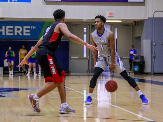UWF's Cameron Cox (1) dribbles against Union University in the last regular season home game at the University of West Florida Field House on Saturday, Feb. 17, 2018.