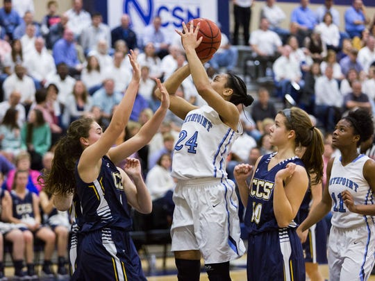 Northpoint ChristianÕs Jade Wells (middle) drives the lane against the Chattanooga Christian defense during first quarter action of their DII Class A Quarter-Finals playoff basketball game, Friday, February 23, 2018. Special to the Commercial Appeal/Kaitlyn Becker Johnson
