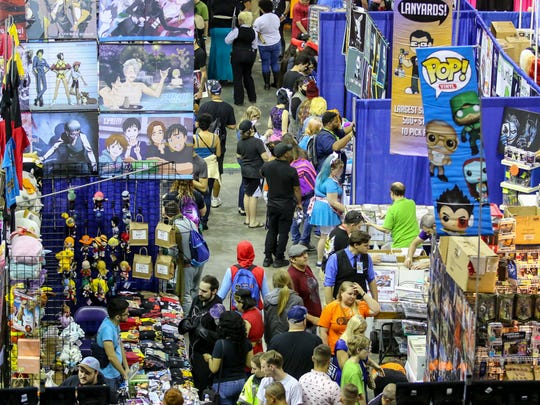 People make their way to and through the Pensacola Bay Center on the final day of Pensacon on Sunday, Feb. 25, 2018.