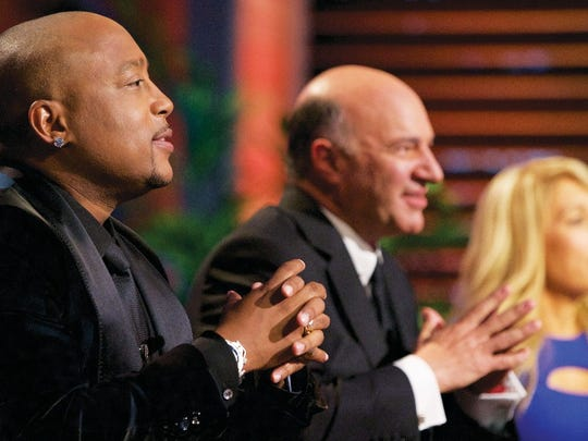Daymond John, Kevin O'Leary and Lori Greiner listen