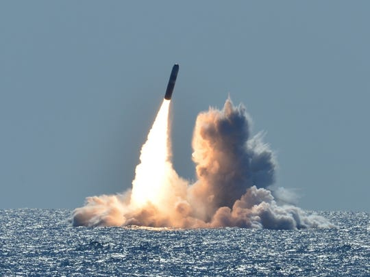"An unarmed Trident II D5 missile launches from the Ohio-class ballistic missile submarine USS Nebraska  off the coast of California in 2008. The Ohio class ballistic missile fleet, including those based at Naval Base Kitsap-Bangor, are getting a new kind of ""low-yield"" nuclear warhead on board."