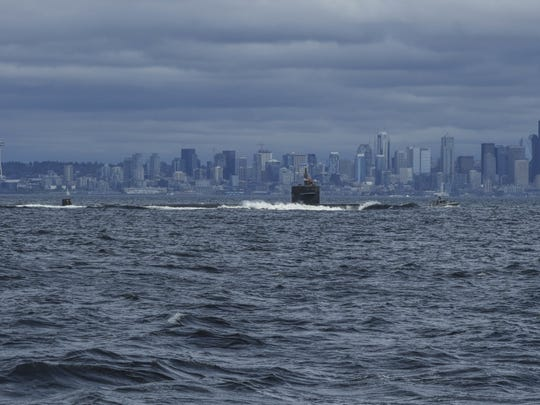 The USS Bremerton transits Puget Sound to its final home in Bremerton in April 2018 for decommissioning.