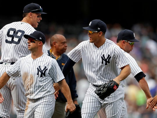 Yankees left fielder Giancarlo Stanton (27) and New