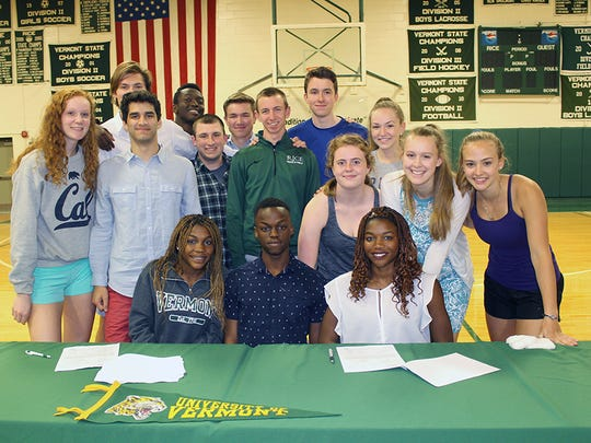 Dina and Sonia John pose with their Rice track and field teammates after signing with the University of Vermont. The sisters will compete for the Catamounts starting in the fall.