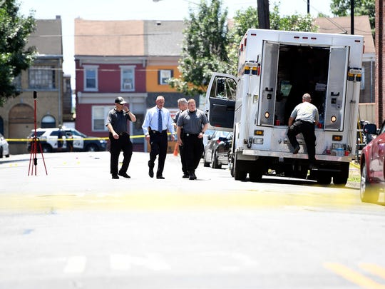 Investigators on the scene Sunday afternoon where two gunmen opened fire during the Art All Night Festival in Trenton early morning Sunday, June 17, 2018.