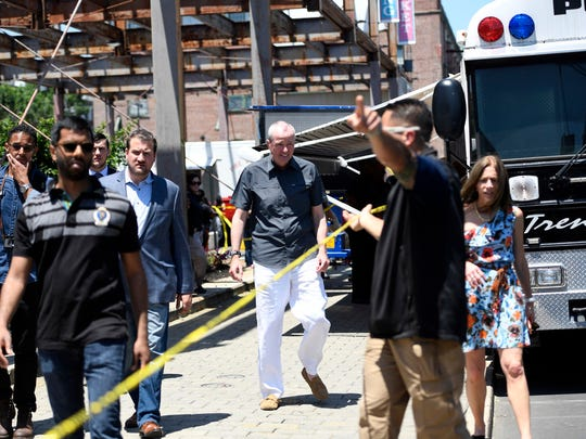 Governor Phil Murphy and wife Tammy visit with investigators at the scene of the shooting at the Art All Night Festival in Trenton on Sunday, June 17, 2018.