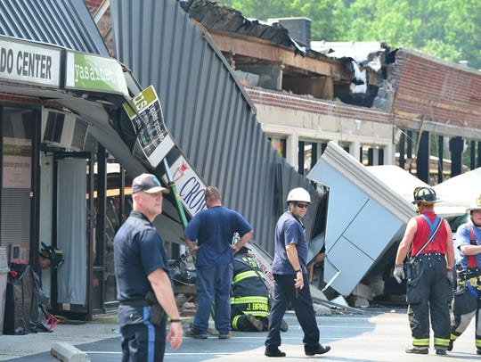 Emergency personnel are at the scene of the collapse