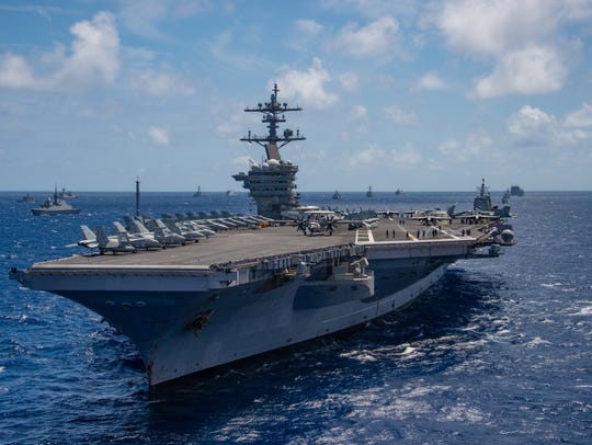 The USS Carl Vinson participates in a group sail during the Rim of the Pacific (RIMPAC) exercise off the coast of Hawaii last month.