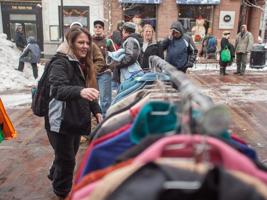 In this file photo, Sweetwaters guests take a closer look at the coat rack on Church Street in Burlington while waiting outside the restaurant for their annual Thanksgiving Day dinner.