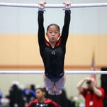 Gymnast Sophia Groth, who trains in West Des Moines, competes in the uneven bars during the National Junior Olympics tryouts on May 15 at Hy-Vee Hall in Des Moines.