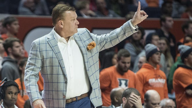 Illinois coach Brad Underwood gestures during a game last season in Champaign. With the season a month away, the Illini still are finalizing their men's basketball schedule.