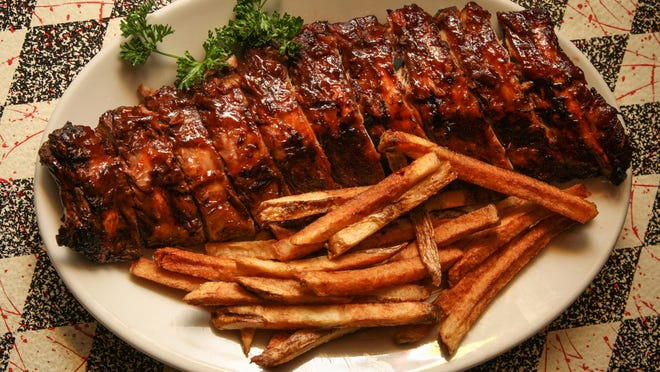 Baby-back ribs with house-made french fries at Memphis Pig Out in Atlantic Highlands.