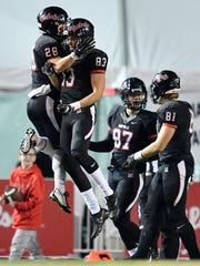 Maryville's Byron Brown (83) celebrates with Noah Humphreys