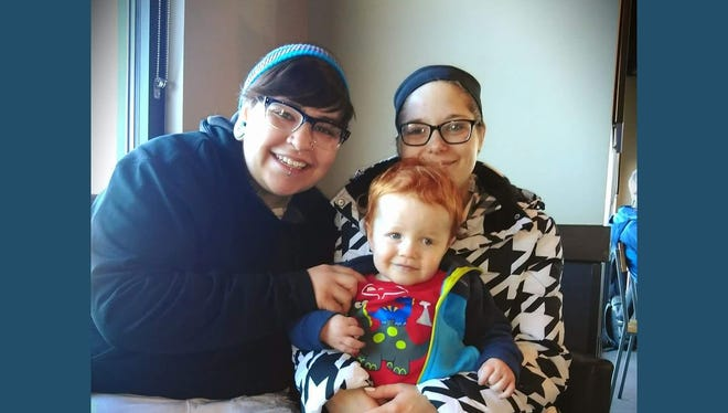 Brittney Roberts, right, is believed to have drowned in the Missouri River. She is pictured here with her fiancee, Jessica Goodman, and son, James.