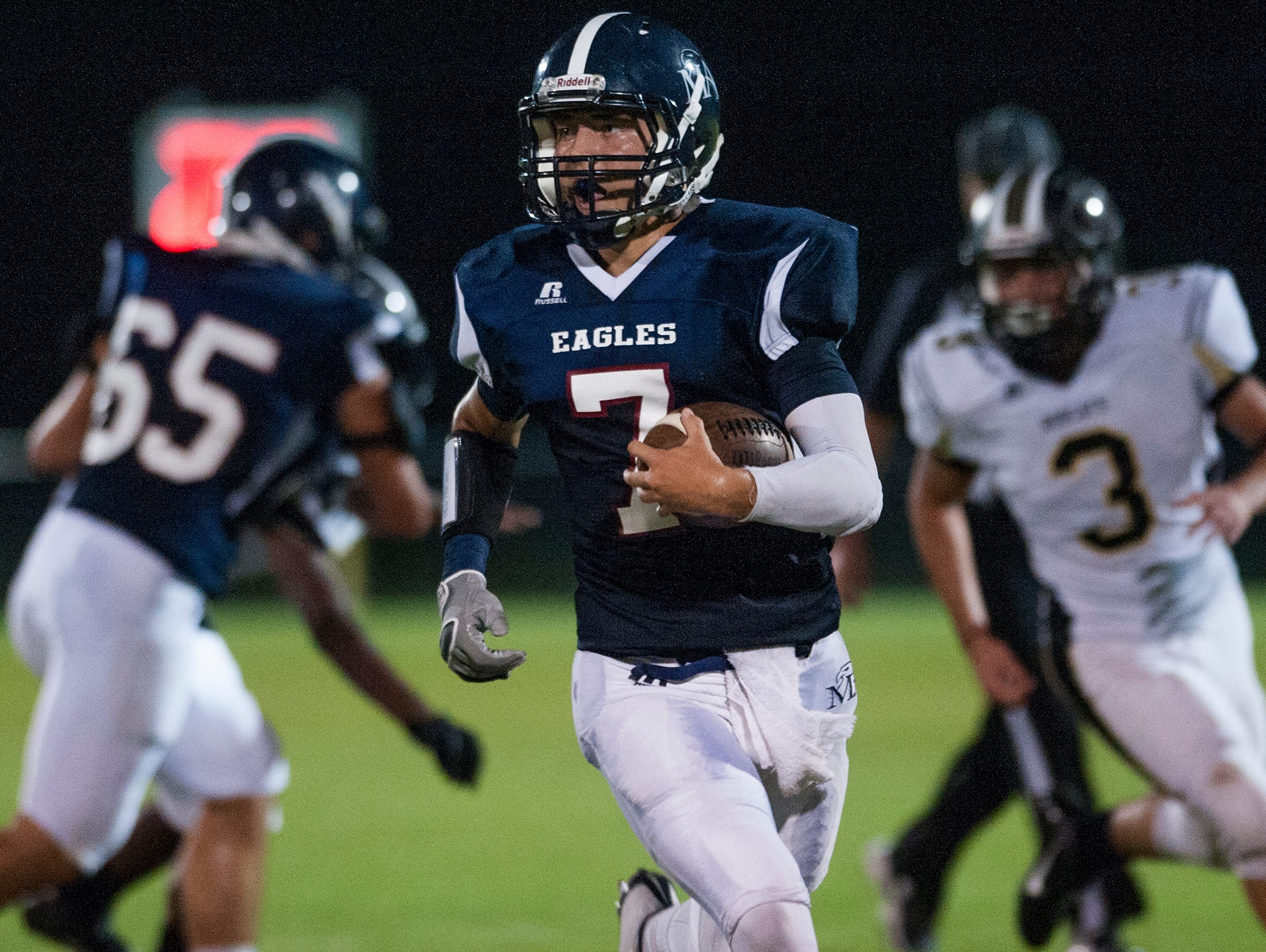 Montgomery Academy's Barton Lester (7) makes a long punt return against Beulah at the MA campus on Friday September 4, 2015 in Montgomery, Ala.