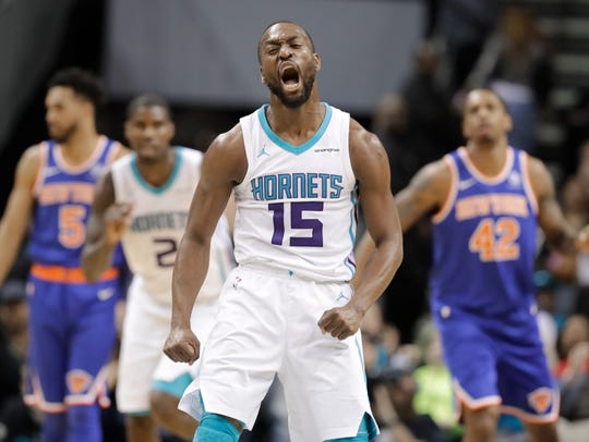 Charlotte Hornets' Kemba Walker (15) reacts to making