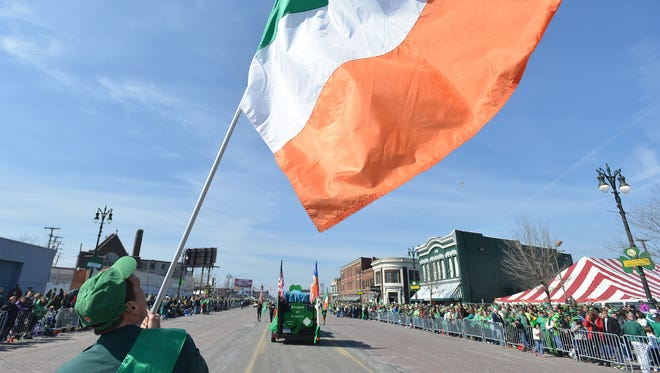 Erin Irwin waves an Irish flag while marching in the 57th annual Detroit St. Patrick's Parade/