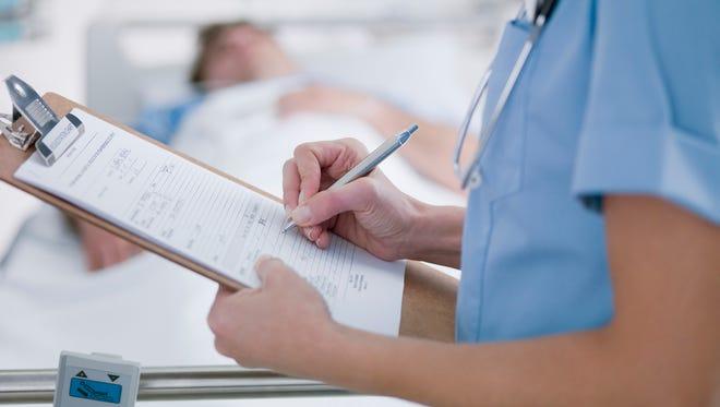 Nurse tending patient