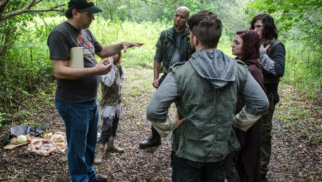 "Director Stephen Wise, left, gives direction to his cast on the set of his short film, ""Sur'vi."""