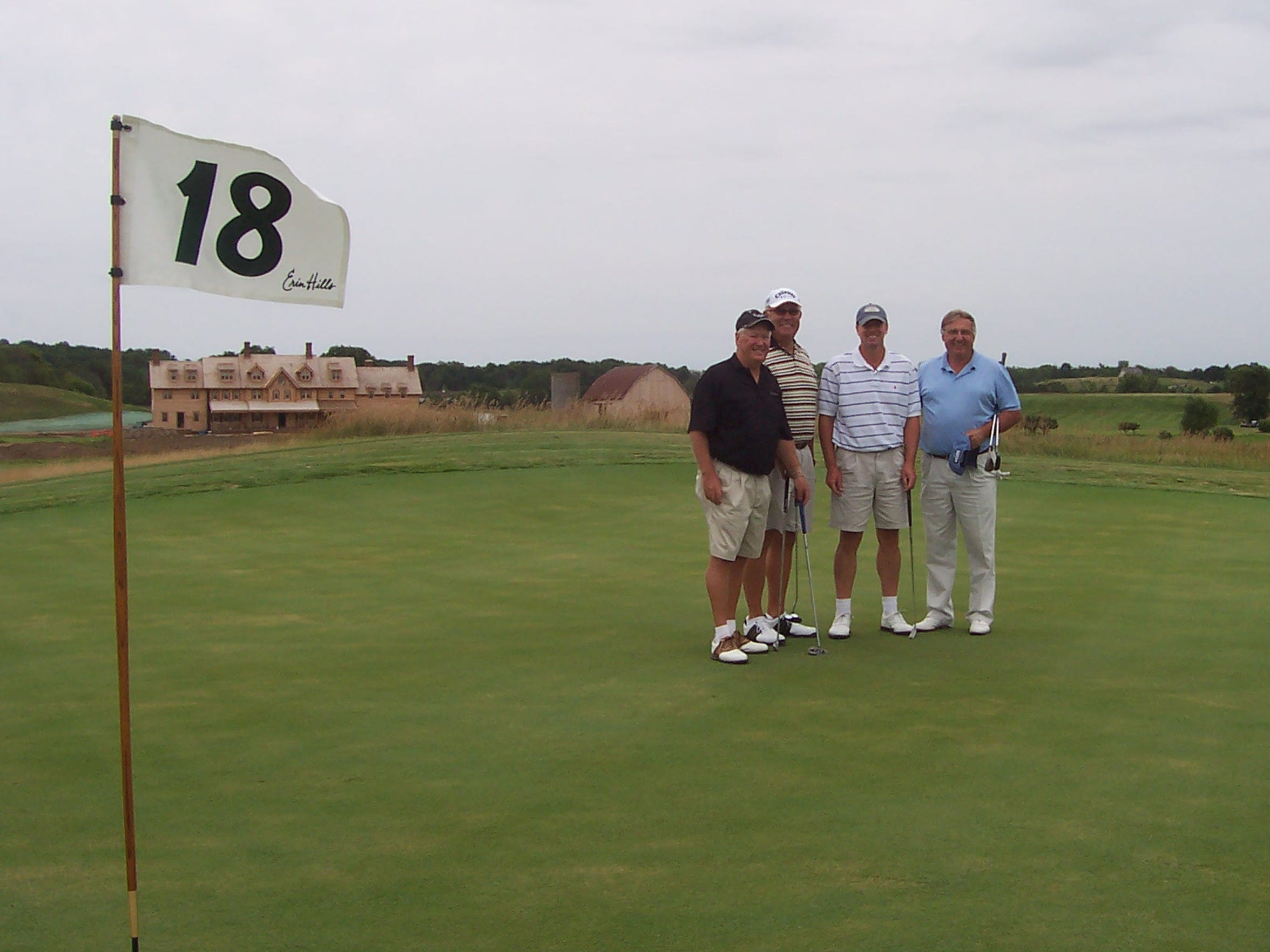 Steve Stricker (second from right) and his father-in-law, PGA professional Dennis Tiziani, pose on the 18th green at Erin Hills with the rest of their foursome after playing the fledgling golf course in July 2006.