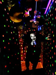 Trixie the Clown (Tracie Russell) waits to greet guests