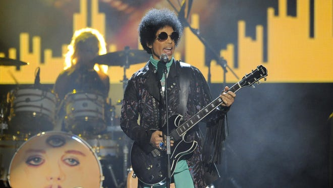 Prince performs in 2013 at the Billboard Music Awards at the MGM Grand Garden Arena in Las Vegas.