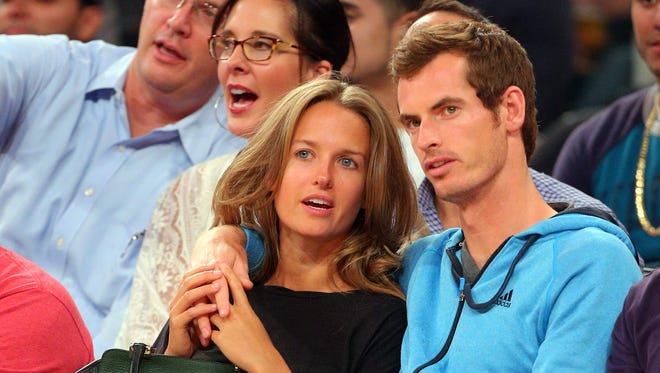 Tennis star Andy Murray (right) talks with his girlfriend Kim Sears (left) during the fourth quarter of a game between the United States and Puerto Rico at Madison Square Garden. Murray and Sears  are set to wed.