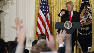 President Donald Trump calls on a reporter during a news conference, Thursday, Feb. 16, 2017, in the East Room of the White House in Washington.