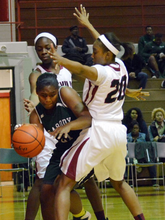 ANI Pineville vs. Peabody girls Peabody's Gabrielle Gray (21, green, left) ***ROSTER HAS HER LISTED AS GABRIEL***) looks to get past Pineville's Catina Hayes (20, right) Tuesday, Jan. 6, 2015.-Melinda Martinez/mmartinez@thetowntalk.com