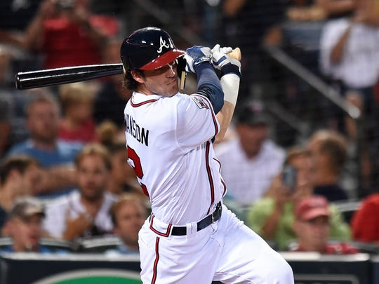 Atlanta Braves shortstop Dansby Swanson (2) collects his first major league base hit against the Minnesota Twins during the fourth inning on Aug. 17, 2016.