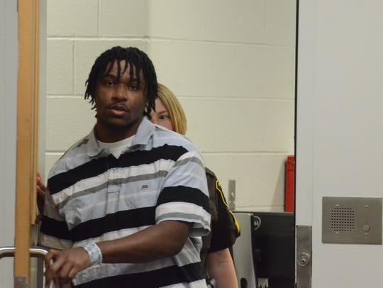 Rayjahn Heltzel enters the courtroom to begin his trial.