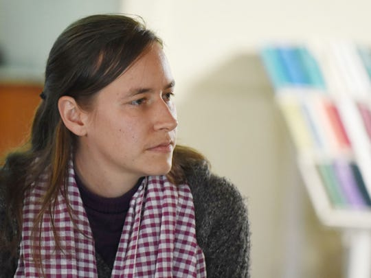 Bethany Loberg listens to questions during her presentation about Cambodia and El Salvador on Sunday, Jan. 25, 2015, at the Salem Friends Meeting House. Loberg and her mother, Frances, took a trip to Cambodia in January, 16 years after their family served for a year in the country with the Mennonite Central Committee, a relief and development agency.