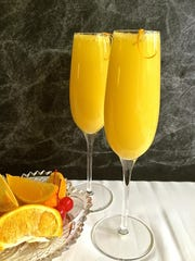 Citrusy mimosas would be the highlight of breakfast in bed or brunch for Mom