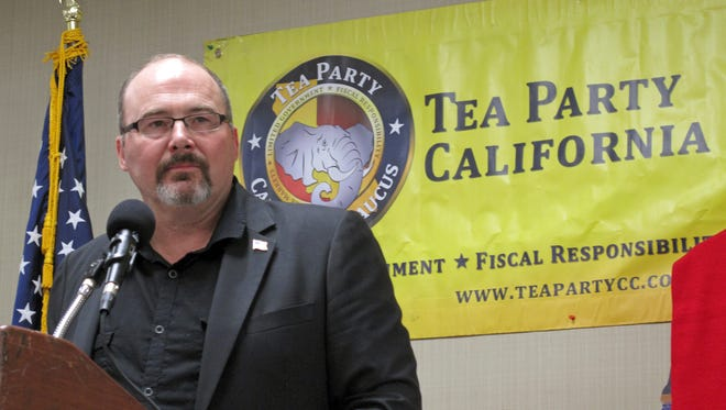 Former California Assemblyman Tim Donnelly, who ran for governor in 2014, speaks at a meeting of the California Tea Party in Fresno on Friday.
