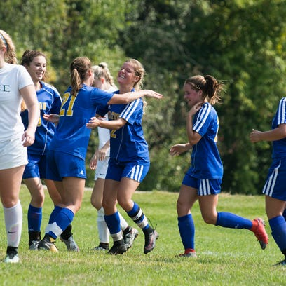 Milton celebrates a goal during the girls soccer game