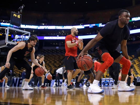 Texas Tech's Keenan Evans, right, dribbles during practice at the NCAA men's college basketball tournament in Boston, Thursday, March 22, 2018. Texas Tech faces Purdue in a regional semifinal on Friday night. At left is Avery Benson. (AP Photo/Charles Krupa)