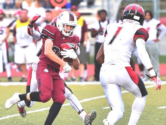 Milford's Billy Cawthorne (with ball) makes the catch