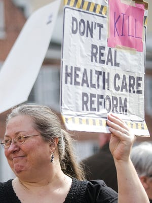 "OIn this file photo, Heather Bradford, of Spring Garden Township, holds up her ""Don't Kill Real Health Care Reform"" sign, during the Indivisible York demonstration, Tuesday, Feb. 28, 2017, at Continental Square. Amanda J. Cain photo"