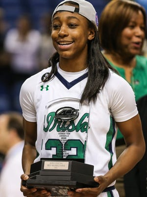 Mar 8, 2015; Greensboro, NC, USA; Notre Dame Fighting Irish guard Jewell Loyd (32) with her MVP trophy during the Championship game at the Greensboro Coliseum Complex. Notre Dame wins the ACC Womens' Basketball Championship 71-58 over Florida State. Mandatory Credit: Jim Dedmon-USA TODAY Sports