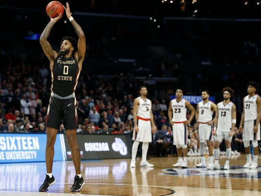 Gonzaga players watch as Florida State forward Phil Cofer (0) shoots free throws during the second half of an NCAA men's college basketball tournament regional semifinal Thursday, March 22, 2018, in Los Angeles. (AP Photo/Alex Gallardo)