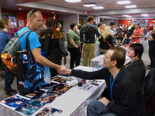 The second day of Pensacon 2015 drew the expected large crowds Saturday at the Pensacola Bay Center. Some of the people arriving at the event had to be seated inside the Bay Center to keep the main floor from becoming overcrowded. In this photo well known actor, right, Michael Biehn, star of such films as Terminator and Aliens among many others, shakes hands with fan Clifton Gill in the autograph room of Pensacon.