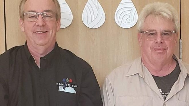 Allan Chabon (left) and his brother, Jeffrey, opened an Elements Massage franchise at The Shops of Donald Ross Village last month. The business, which offers personalized, therapeutic massage services, is one of seven in Florida.