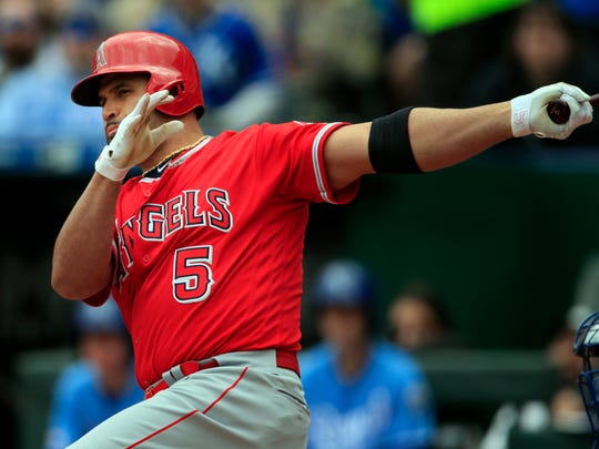 Los Angeles Angels' Albert Pujols hits a two-run double off Kansas City Royals starting pitcher Homer Bailey during the first inning of a baseball game at Kauffman Stadium in Kansas City, Mo., Sunday, April 28, 2019. (AP Photo/Orlin Wagner)