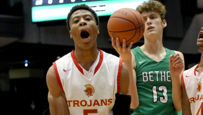 North College Hill's Lorenzo Sparks (5) reacts during the Trojans district final against Bethel Tuesday, March 6, 2018