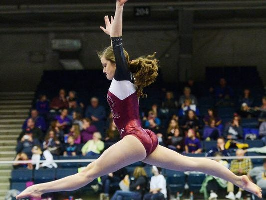 Madison's Jenni Giles earned the all-around title with the top marks in all four events at the state gymnastics meet in Brookings.