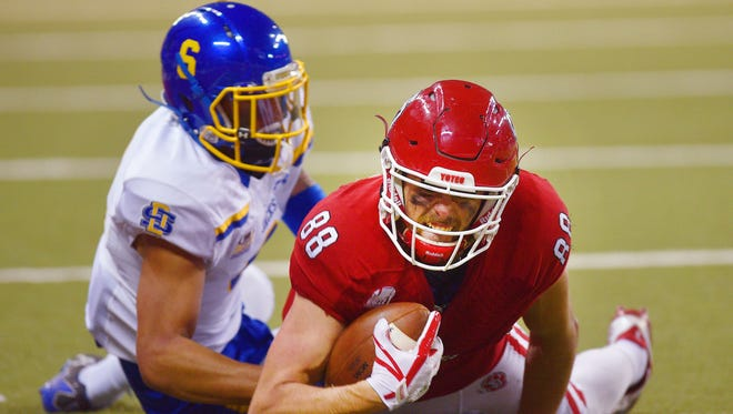 USD's Brandt Van Roekel catches the ball during the game against SDSU Saturday, Nov. 18, at the DakotaDome in Vermillion.