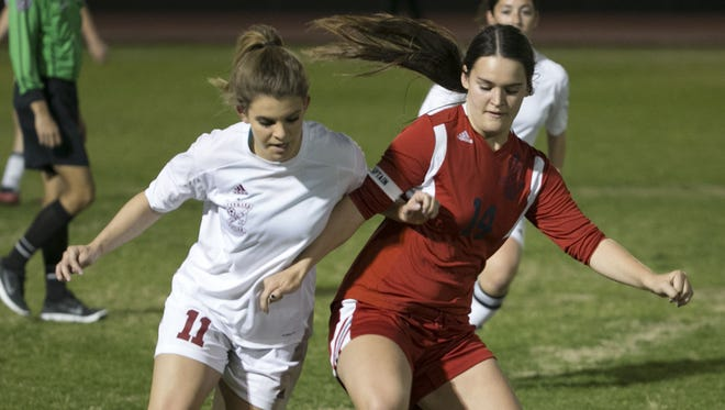 Peoria Centennial's Haley Beck, right, gets around Lauren Carlson during a game against Glendale Ironwood in Glendale on Jan. 25.
