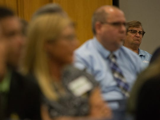 AtTAck Addiction advocate David Humes listens as a marijuana legalization proponent speaks during public comment at a roundtable at DelTech in Wilmington Thursday.